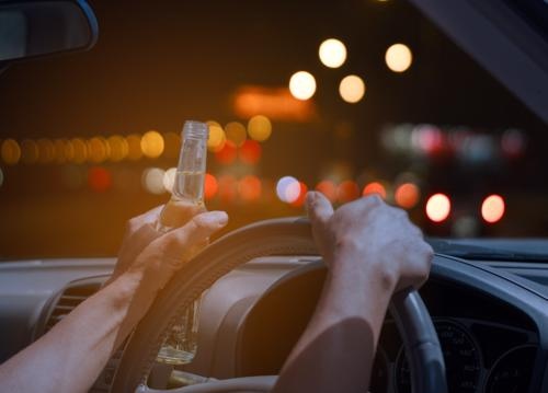 A man drinking while driving. Car accident liability.