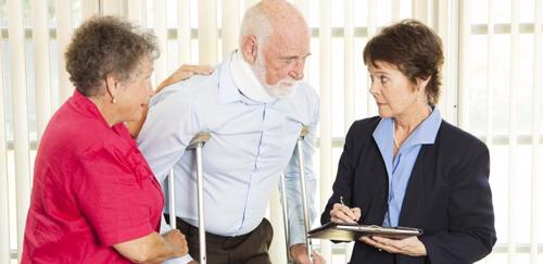 A man meeting with a personal injury attorney in Garden Grove after suffering a neck injury.