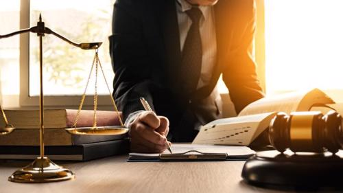 A lawyer in Irvine filing a wrongful death claim for a client.