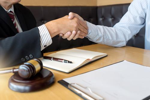 A La Quinta personal injury lawyer shaking hands with a client.