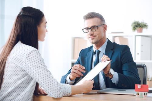 A woman meeting with an Orange County sideswipe lawyer.