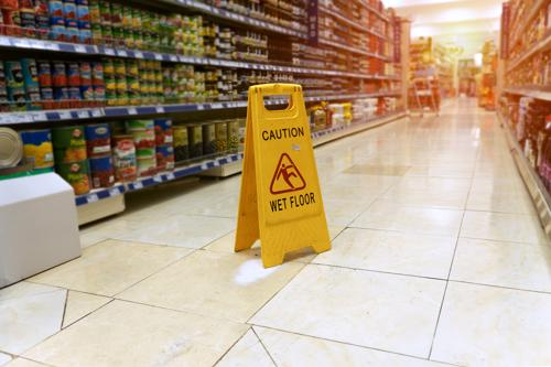 Caution wet floor sign in grocery store.