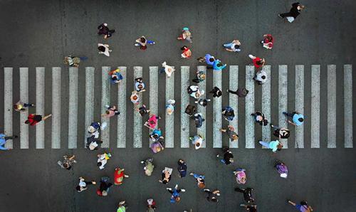 An overhead shot of a busy crosswalk.