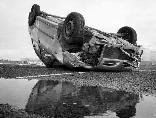 An upside down car after a rollover accident on an Orange County freeway.