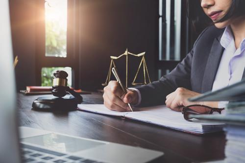 An attorney in Santa Ana reviewing a car accident claim.