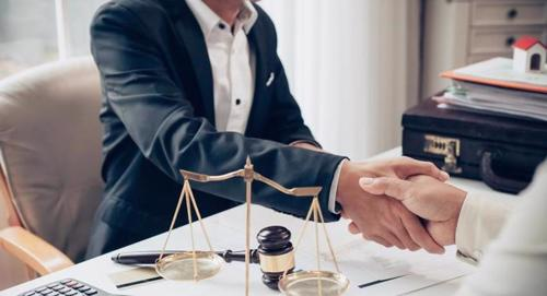 Palm Springs catastrophic injury lawyer shaking hands in settlement agreement