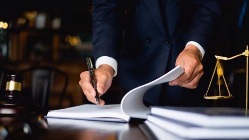 An attorney in Santa Ana reviewing a clients claim for wrongful death compensation.