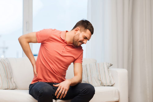 Man with back pain. Contact an Orange County back injury lawyer today!