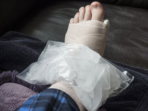 Ice pack on hurt ankle. Contact our Orange County foot and ankle injury attorneys.