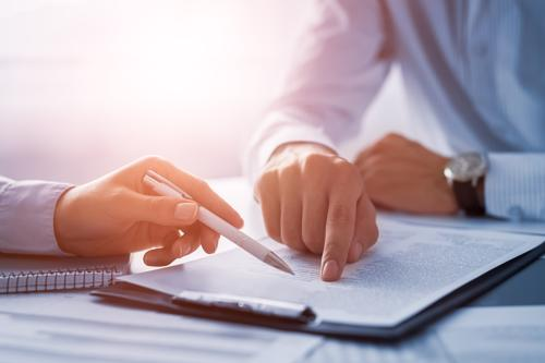 An Orange County soft tissue injury lawyer reviewing a claim with a client.