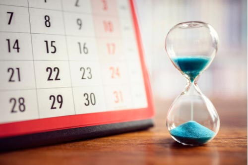 Calendar and hourglass, statute of limitations concept,
