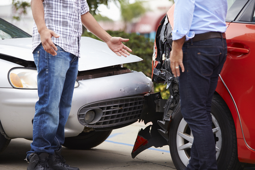 This is an image of two men arguing over a car accident before calling an Indian Wells car accident lawyer