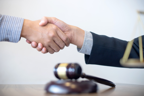 This is an image of a man shaking the hand of his Morongo Valley car accident lawyer