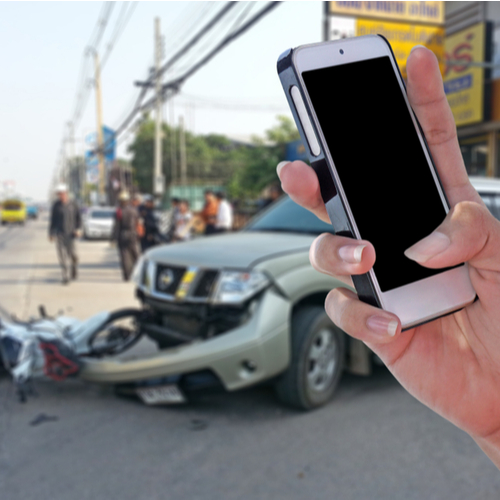This is an image of a person about to call an Indian Wells car accident lawyer following a car accident
