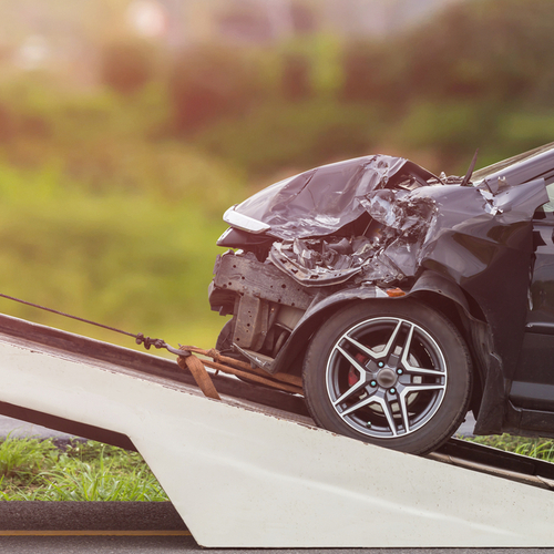 This is an image of a damaged front end of car following a car accident in Indian Wells California