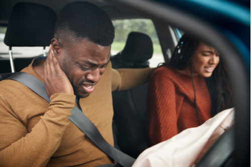 Driver and passenger in car crash with neck pain