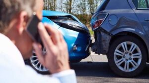Man calling car accident lawyer after wreck, liability for accident
